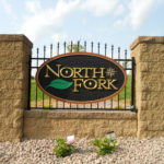 farm sign with landscape pavers, finials, gilding