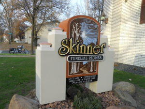 Sandblasted, gilded carved sign for funeral home