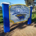 sandblasted high school sign